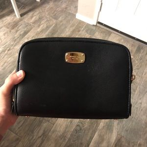 Michael Kors crossbody purse with gold accents